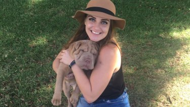 Rebecca Tannous with her friend's dog in Rushcutters Bay Park.