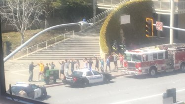 Employees evacuate the YouTube headquarters in San Bruno, California after reports of an active shooter.