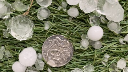 Heavy rain, hail and 100km/h winds lash Melbourne in peak hour