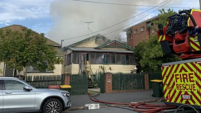 Man rushed to hospital after house fire in Brisbane's inner north