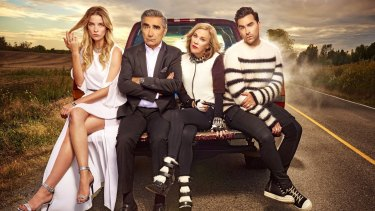 Annie Murphy as Alexis, Eugene Levy as Johnny, Catherine O'Hara as Moira and Daniel Levy as David in Schitt's Creek.