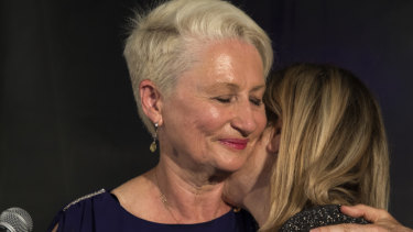 Kerryn Phelps is embraced by her wife Jackie Stricker-Phelps during her victory speech on Saturday night.