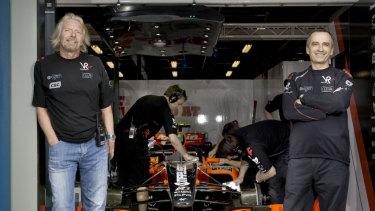 Sir Richard Branson and John Borghetti withthe Virgin Racing Formula One car.