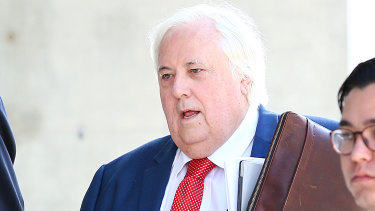 Businessman Clive Palmer arrives to the Supreme Court in Brisbane on Thursday.