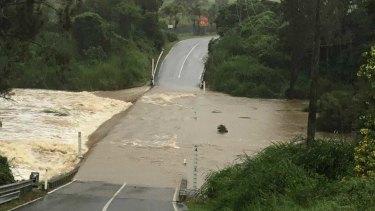 Rain leaves a deluge that blocks roads in the Gold Coast hinterland