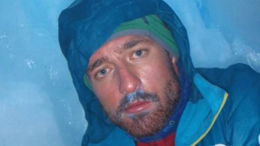 Terry Harch sheltering in a narrow crevasse awaiting rescue from Mount Tasman in 2013.