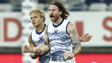 Zach Tuohy celebrates a goal during the round 21 match between Geelong and the Greater Western Sydney Giants.