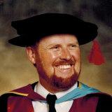 Dr Geoff Crawford graduates.