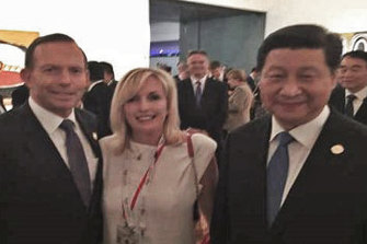 Then prime minister Tony Abbott with Christine Holgate, chief executive of Australia Post, and Chinese President Xi Jinping at the G20 meeting in Brisbane in 2014. The photo was taken on Ms Holgate's smuggled iPhone.