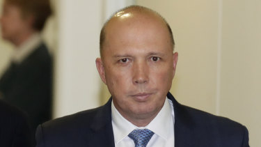 Peter Dutton exits the partyroom meeting.