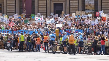 Students protesting against government inaction on climate change, in Melbourne on Friday.