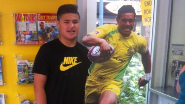 A young Josh Schuster with a cardboard cut-out of his uncle, Australian Sevens star Peter Schuster.