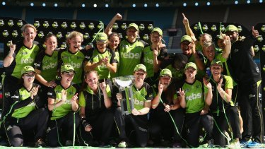 Champions: Sydney Thunder celebrate their WBBL01 title.