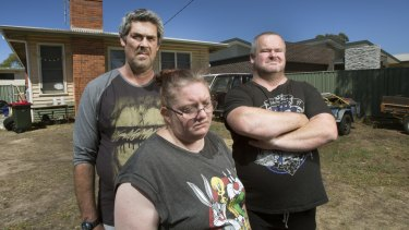 From left: Ronald Lyons, Christine Lyons and Peter Arthur outside their home in the days after Samantha Kelly went missing.
