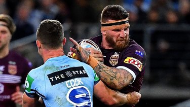 Controversial figure: Josh McGuire charges into the Blues during the Origin decider.