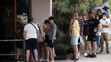 People queue outside a Centrelink office in Sydney. In April alone, more than 221,000 people lost their jobs in NSW.