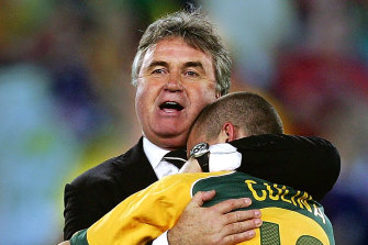 Guus Hiddink and Tim Cahill celebrate the Socceroos' drought-breaking qualification for the 2006 World Cup.