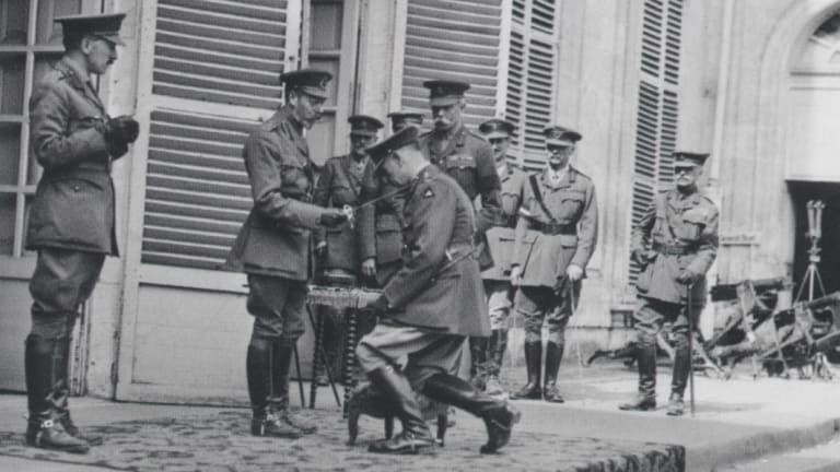 King George V knights Sir John Monash at the Australian Corps headquarters in France, 1918.