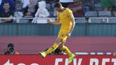 Happy days: Apostolos Giannou celebrates after scoring Australia's third goal against Palestine.