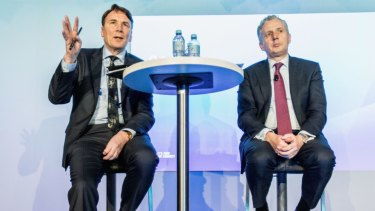 Former Telstra chief executive David Thodey and current boss Andrew Penn.