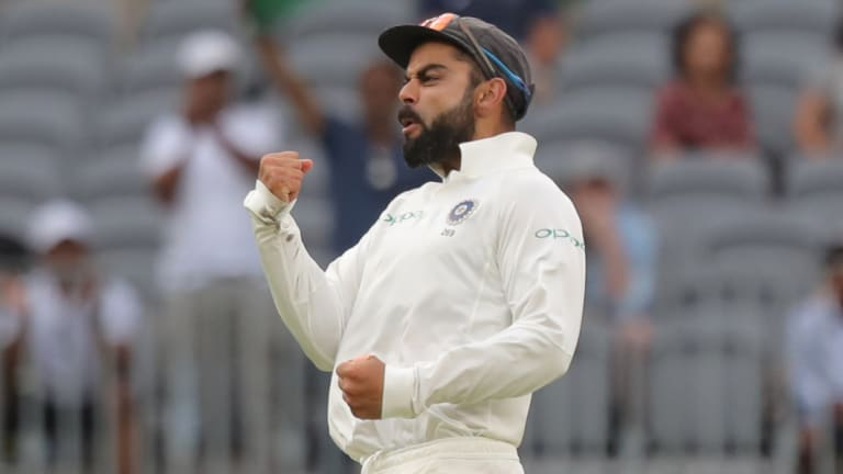Rolling with the punches: Virat Kohli led the Indian fightback.