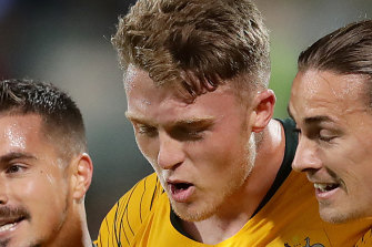 Goal-scorer Harry Souter, centre, with Socceroo teammates in 2019.