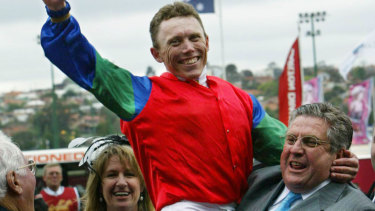 Dream: Whitby celebrates with jockey Chris Munce after winning the 2004 Cox Plate with Savabeel.
