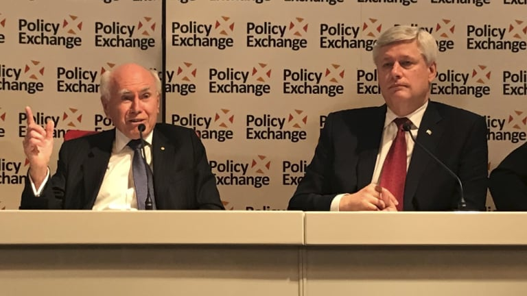 Former PM John Howard and former Canadian PM Stephen Harper speak at a Policy Exchange seminar in London.