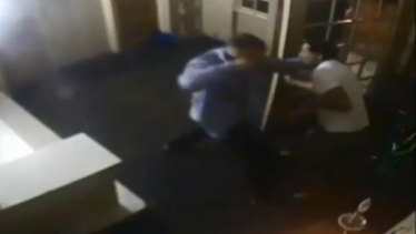 Shocking: Stills from CCTV footage show Lodge swinging wildly before being arrested by New York police.