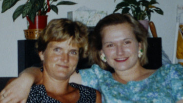 Chris Rau, left, with Cornelia after she was found in the Baxter detention camp in 2005.