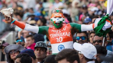 Colourful: Sudhir Gautam is an Indian supporter who travels the world supporting the Indian cricket team.