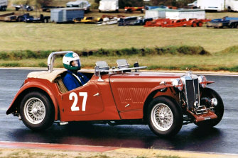 Danny Richards with his red 1949 MG-TC.