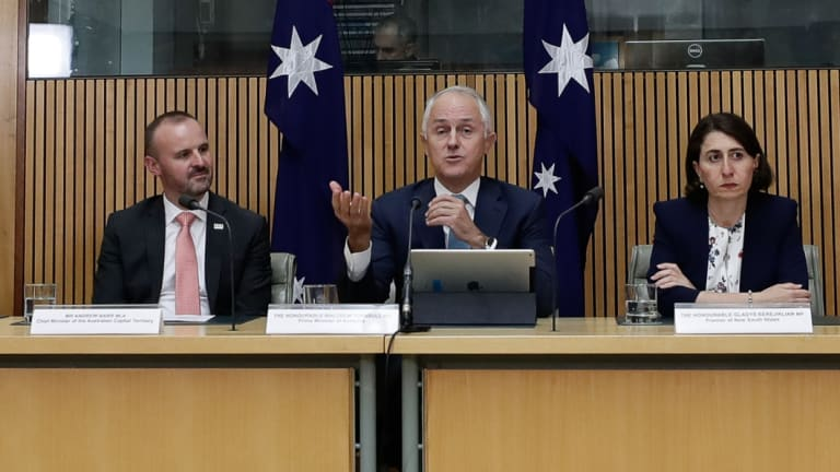 """ACT Chief Minister Andrew Barr, then prime minister Malcolm Turnbull, and NSW Premier Gladys Berejiklian. The ACT is the only jurisdiction that does not refer to ministers as """"the Honourable""""."""