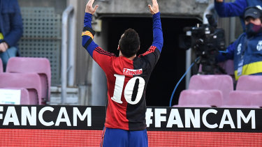 Lionel Messi of Barcelona celebrates after scoring their sides fourth goal while wearing a Newell's Old Boys shirt with the number 10 on the back in memory of former footballer, Diego Maradona.