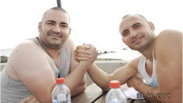Brothers in arms: Bekim Zogaj (aka Aniello Vinciguerra) and George Nika pose for a photograph during a rest stop in South Australia in November 2014.