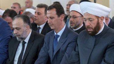 Syrian President Bashar Assad, second from left, prays on the first day of Eid al-Adha at al-Rawda mosque, in Damascus, Syria, last week.