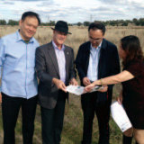 Humphrey Xu, left, in a newsletter sent by Daryl Maguire in 2013. He was in Wagga amid talks over the proposed $400 million development. Also pictured is Wagga council general manager Phil Pinyon, Wang Jian and Lydia Zhang.