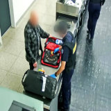 The 61-year-old German Gypsy Jokers member has his luggage inspected at Perth Airport.
