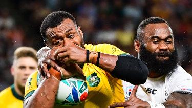 Fiji's Semi Radradra wraps up the Wallabies' Fijian-born centre Samu Kerevi in their opening World Cup match.