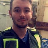 Child sex offender Blake Ross wearing an EMS vest.