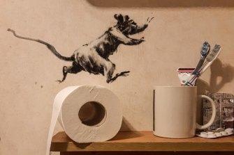 Banksy follows stay-at-home orders and makes bathroom art during coronavirus crisis.