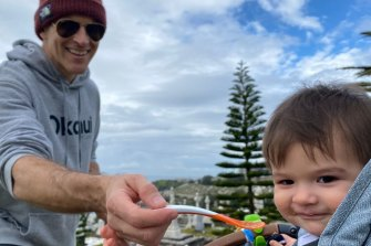 Osher feeding son Wolfgang – the reason trackies are the go.