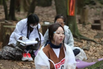 Participants in the annual Space Out Competition in a forest on South Korea's Jeju island.