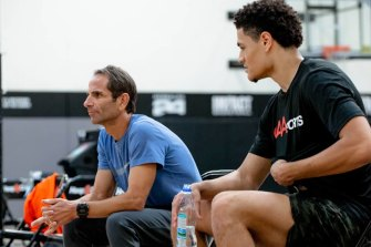 Australian NBA Draft hopeful Josh Green (right) speaks with trainer Joe Abunassar at IMPACT Basketball in Las Vegas.