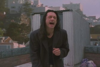 Tommy Wiseau in the 2003 film The Room.