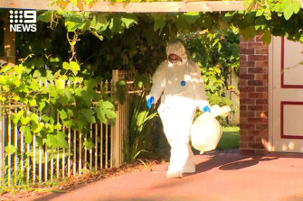 A crime scene has been established and forensic specialists are examining the home in Croydon.