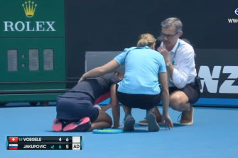 Dalila Jakupovic had a coughing fit on court and was seen struggling on her knees and receiving medical attention in the second set of her match with Stefanie Vogele.
