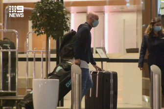 Australian cricketers leaving quarantine.
