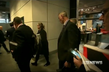 Federal police raiding the ABC headquarters in Sydney in 2019.