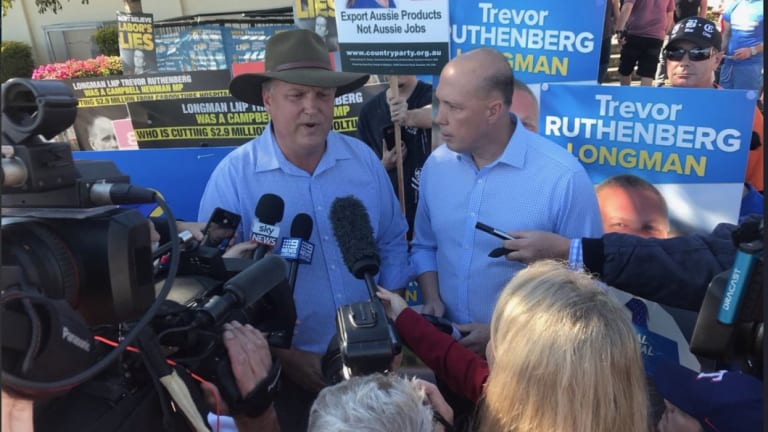 Federal Immigration minister Peter Dutton (Dickson) campaigns with Trevor Ruthenberg in his neighbouring seat of Longman during the Super Saturday election.